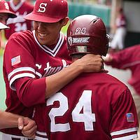 STANFORD, CA - April 23, 2011: Chris Jenkins of Stanford baseball hugs Jake Stewart after scored the tying run during Stanford's game against UCLA at Sunken Diamond. Stanford won 5-4.