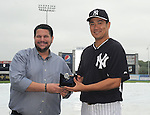 (L-R) Mark Feinsand, Masahiro Tanaka (Yankees),<br /> MARCH 29, 2014 - MLB :<br /> Masahiro Tanaka of the New York Yankees receives the 2014 James P. Dawson Award, given annually to the outstanding Yankees rookie in spring training, from Mark Feinsand of the New York Daily News, representing the New York chapter of the Baseball Writers' Association of America, before a spring training baseball game against the Miami Marlins was rained out at George M. Steinbrenner Field in Tampa, Florida, United States. (Photo by AFLO)