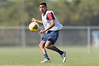 Julian Araujo of the United States passes the ball