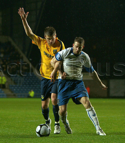 21st November 2009. Barrow's Robin Hulbert (blue and white shirt) is challenged by Kevin Sandwith during the second half. Blue Square Premier League match - Oxford United v AFC Barrow Town at Oxford, Oxfordshire, England. Photo: Colin Read/Actionplus Editorial Use Only