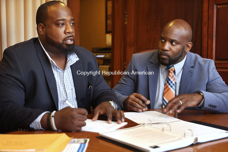 WATERBURY CT. 07 Augusr 2017-080717SV03-From left, Marcus Stallworth and Anthony Gay of Welcome 2 Reality work in their office in Waterbury Monday. <br /> Steven Valenti Republican-American