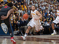 Justin Cobbs of California dribbles the ball during the game against Stanford at Haas Pavilion in Berkeley, California on February 5th, 2014.  Stanford defeated California, 80-69.