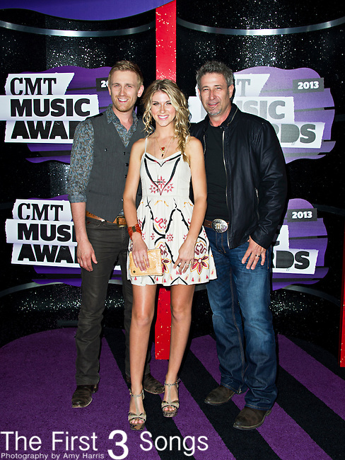 Brian Henningsen, Aaron Henningsen, and Clara Henningsen of The Henningsens arrive at the 2013 CMT Music Awards at Bridgestone Arena in Nashville, Tennessee.