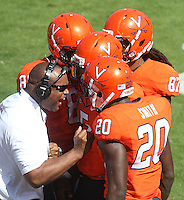 Virginia head coach Mike London congratulates his players during the football game Saturday Oct. 5, 2013 at Scott Stadium in Charlottesville, VA. Ball State defeated Virginia 48-27. Photo/The Daily Progress/Andrew Shurtleff