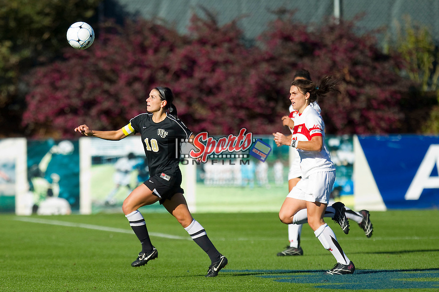 Bianca D'Agostino #10 of the Wake Forest Demon Deacons chases after a loose ball as Molly Deska #21 of the Maryland Terrapins is in pursuit at the 2010 ACC Women's Soccer Championship at WakeMed Soccer Park on November 7, 2010 in Cary, North Carolina.  The Demon Deacons defeated the Terrapins 3-1 in penalty kicks.  Photo by Brian Westerholt / Sports On Film