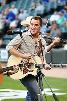 Country music star Easton Corbin performs a set on field before a Chicago White Sox game against the Toronto Blue Jays on August 15, 2014 at U.S. Cellular Field in Chicago, Illinois.  Chicago defeated Toronto 11-5.  (Mike Janes/Four Seam Images)