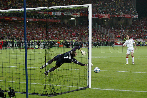 25 May 2005: Liverpool goalkeeper Jerzy Dudek dives to his right to save Andrea Pirlo's penalty during the shoot-out in their UEFA Champions League Final victory over AC Milan played at the Ataturk Olympic Stadium, Istanbul, Turkey. Liverpool beat AC Milan 3-2 on penalties after the game finished 3-3 after extra time, and lifted the European Cup for the fifth time. Photo: Neil Tingle/actionplus..050525 football soccer player keeper