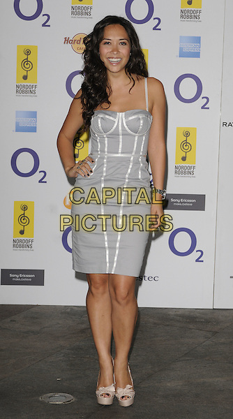 MYLEENE KLASS .At the O2 Silver Clef Awards, Hilton Park Lane hotel, London, England, UK, July 2nd 2010..full length white grey gray silver bustier dress beige cream platform peep toe shoes bows hand on hip .CAP/CAN.©Can Nguyen/Capital Pictures.