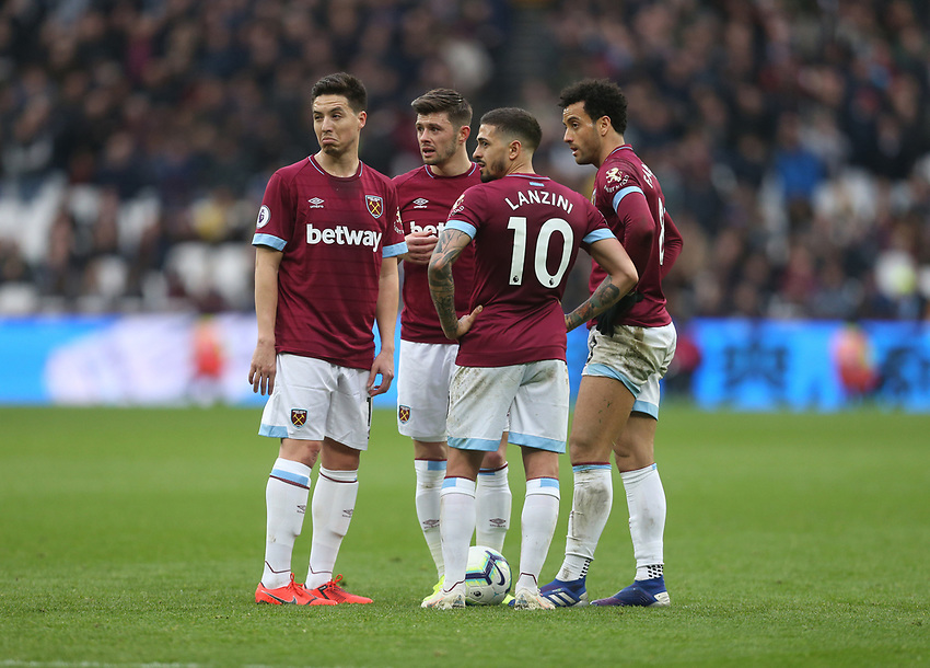 West Ham United's Manuel Lanzini, Samir Nasri, Aaron Cresswell and Felipe Anderson deliberate over a free-kick<br /> <br /> Photographer Rob Newell/CameraSport<br /> <br /> The Premier League - West Ham United v Huddersfield Town - Saturday 16th March 2019 - London Stadium - London<br /> <br /> World Copyright © 2019 CameraSport. All rights reserved. 43 Linden Ave. Countesthorpe. Leicester. England. LE8 5PG - Tel: +44 (0) 116 277 4147 - admin@camerasport.com - www.camerasport.com