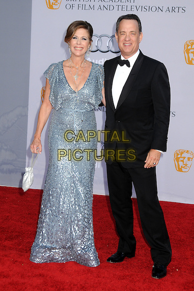 Rita Wilson & Tom Hanks.BAFTA Brits to Watch Event held at the Belasco Theatre, Los Angeles, California, USA, 9th July 2011..full length blue dress  paillettes sequined sequin long maxi  white bag husband wife black tuxedo tux bow tie .CAP/ADM/BP.©Byron Purvis/AdMedia/Capital Pictures.