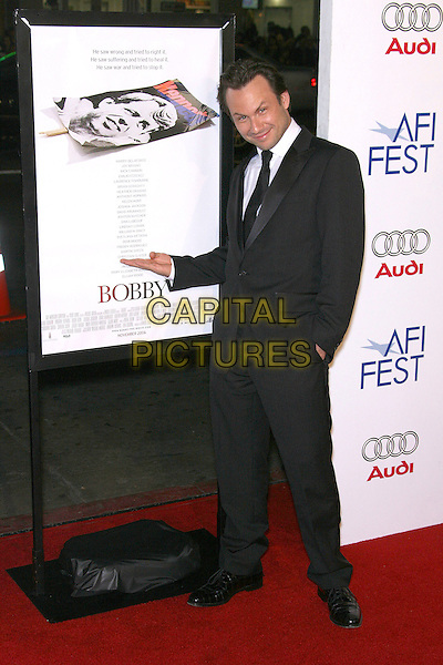 "CHRISTIAN SLATER.AFI Fest 2006 Opening Night Gala and US Premiere of ""Bobby"" - Arrivals held at Mann's Chinese Theatre, Hollywood, California, USA,.1st November 2006..full length funny hand pointing to poster gesture.Ref: ADM/ZL.www.capitalpictures.com.sales@capitalpictures.com.©Zach Lipp/AdMedia/Capital Pictures."