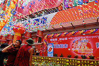 Monks at a Chinese supermarket opening in the city of Lhasa, Tibet, China. Lhasa is increasingly becoming more of a Chinese looking and influenced city as the mainland authorities push to increase the influence of the ruling Han Chinese in this Tibetan city..15 Jul 2006