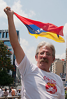 Venezuela: Caracas,18/02/14 <br /> A man wave a venezuelan flag during the rally in support of Leopoldo L&oacute;pez, in Plaza Brion in Chaca&iacute;to, Caracas. Lopez was then handed to the National Guard, because the government had issued an arrest warrant against him responsible for the violence of the protest 12F, where two students and a member of a pro-government paramilitary group died.  <br /> Adolfo Acosta/Archivolatino