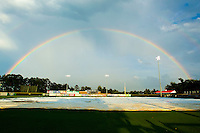 A double rainbow appears over Burlington Athletic Park after a rain delay during the Appalachian League game between the Danville Braves and the Burlington Royals on August 14, 2011 in Burlington, North Carolina.  The Braves defeated the Royals 10-2 in a game called by rain in the bottom of the 8th inning.   (Brian Westerholt / Four Seam Images)