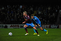 Fleetwood Town's midfielder George Glendon (18) closes down Scunthorpe Utd's midfielder Neal Bishop (12) during the Sky Bet League 1 match between Scunthorpe United and Fleetwood Town at Glanford Park, Scunthorpe, England on 17 October 2017. Photo by Stephen Buckley/PRiME Media Images
