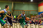 Trae Pemberton, Garveys Tralee Warriors drives hard towards the net with his team mate Duscan Bogdanovic using all his 6'11'' height to police his route.
