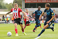 Lincoln City's Harry Anderson under pressure from Bristol Rovers' Edward Upson<br /> <br /> Photographer Rich Linley/CameraSport<br /> <br /> The EFL Sky Bet League One - Lincoln City v Bristol Rovers - Saturday September 14th 2019 - Sincil Bank - Lincoln<br /> <br /> World Copyright © 2019 CameraSport. All rights reserved. 43 Linden Ave. Countesthorpe. Leicester. England. LE8 5PG - Tel: +44 (0) 116 277 4147 - admin@camerasport.com - www.camerasport.com