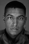 Cpl. Hector Salinas, 22, Houston, Texas. Kilo Company, 3rd Battalion, 1st Marine Regiment, 1st Marine Division, United States Marine Corps, at the company's firm base in Hit, Iraq on Friday Sept. 23, 2005.