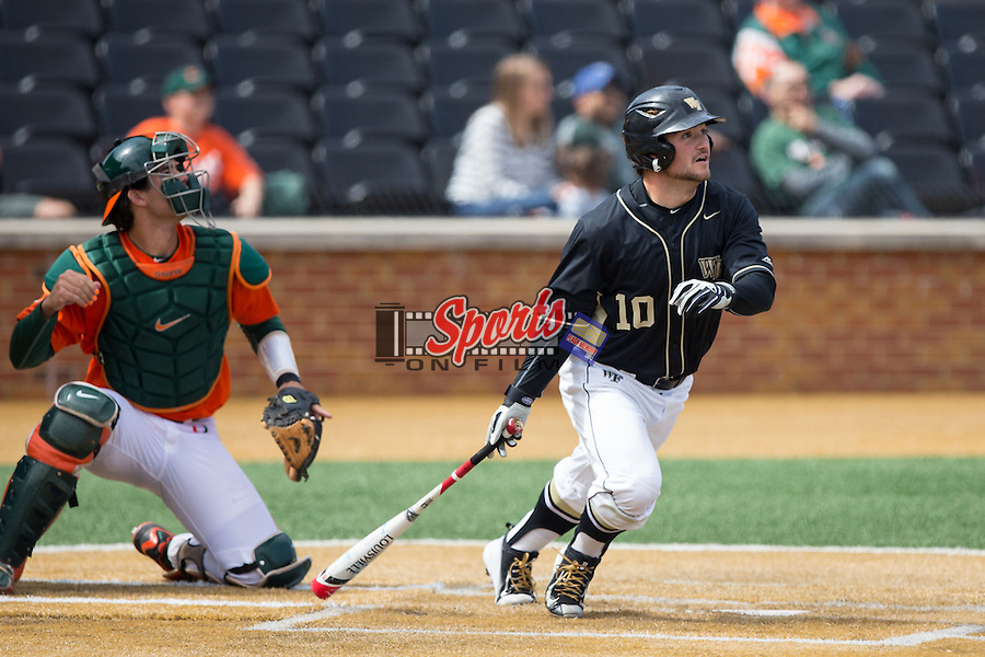 Nate Mondou (10) of the Wake Forest Demon Deacons follows through on his swing against the Miami Hurricanes at Wake Forest Baseball Park on March 22, 2015 in Winston-Salem, North Carolina.  The Demon Deacons defeated the Hurricanes 10-4.  (Brian Westerholt/Sports On Film)