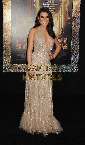 "Lea Michele.The World Premiere of ""New Year's Eve' held at The Grauman's Chinese Theatre in Hollywood, California, USA..December 5th, 2011.full length dress beige gold sparkly halterneck plunging neckline cleavage hand on hip.CAP/ROT/TM.©Tony Michaels/Roth Stock/Capital Pictures"