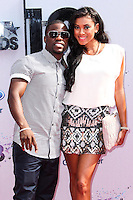 LOS ANGELES, CA - JUNE 30: Kevin Hart and Eniko Parrish attend the 2013 BET Awards at Nokia Theatre L.A. Live on June 30, 2013 in Los Angeles, California. (Photo by Celebrity Monitor)