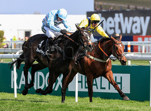 14h April 2018, Aintree Racecourse, Liverpool, England; The 2018 Grand National horse racing festival sponsored by Randox Health, day 3; Noel Fehily on Black Op (4) runs in to win The Betway Mersey Novices' Hurdle