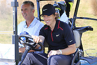 Tommy Fleetwood (ENG) takes the wheel for the start of Tuesday's Pro-Am Day of the 2014 BMW Masters held at Lake Malaren, Shanghai, China 28th October 2014.<br /> Picture: Eoin Clarke www.golffile.ie