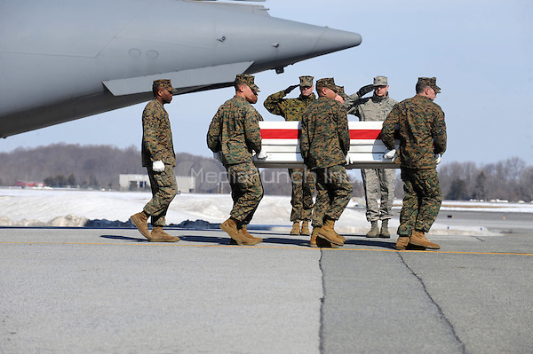 The dignified transfer of fallen United States Marine Corps military personnell at Dover Air Force Base, Delaware, February 20, 2010. The military personell include, Sgt. Jeremy R. McQueary, Lance Corporal Larry M. Johnson, Lance Corporal Kielin T. Dunn and Private First Class Kyle J. Coutu. Credit: Dennis Van Tine/MediaPunch