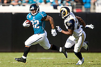 October 18, 2009:      Jacksonville Jaguars running back Maurice Jones-Drew (32) tries to outrun St. Louis Rams safety David Roach (27) duirng action between the NFC West St. Louis Rams and AFC South Jacksonville Jaguars at Jacksonville Municipal Stadium in Jacksonville, Florida. Jacksonville defeated St. Louis in overtime 23-20............