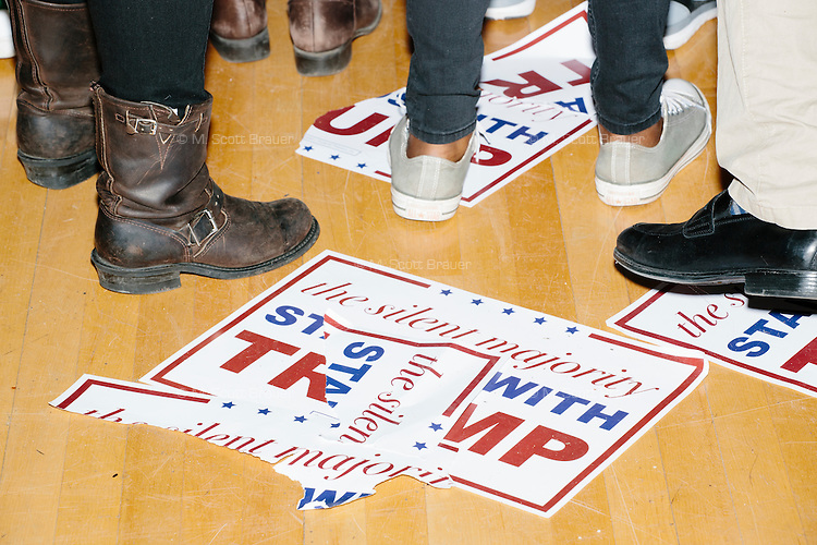Ripped up campaign signs litter the ground after real estate mogul and Republican presidential candidate Donald Trump spoke at a rally at Exeter Town Hall in Exeter, New Hampshire, on Thurs., Feb. 4, 2016.