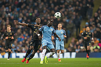 Bacary Sagna of Manchester City battles Moussa Dembele of Celtic during the UEFA Champions League GROUP match between Manchester City and Celtic at the Etihad Stadium, Manchester, England on 6 December 2016. Photo by Andy Rowland.