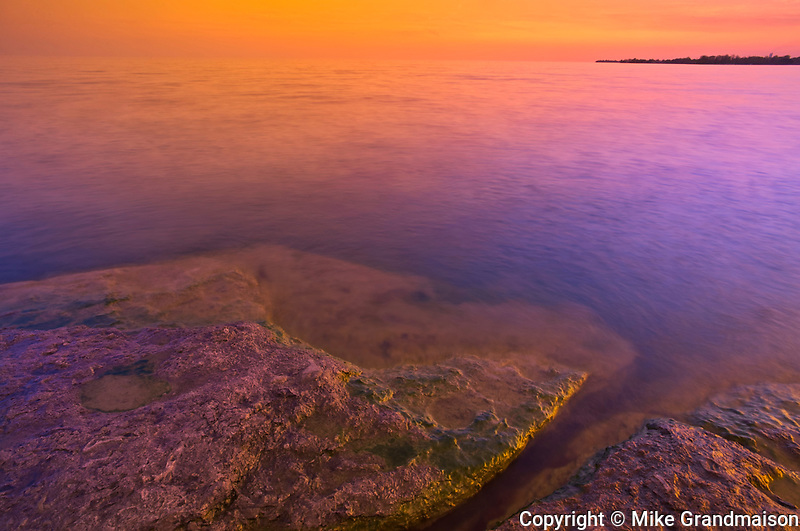 Morning light on rocky shoreline of Lake Erie<br />