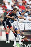 11 July 2009: New England's Steve Ralston (left) and Kansas City's Herculez Gomez (right) challenge for a header. The New England Revolution played the Kansas City Wizards at Gillette Stadium in Foxboro, Massachusetts in a regular season Major League Soccer game.