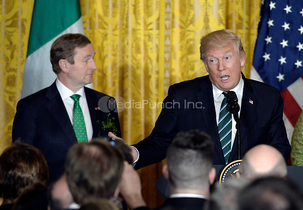 United States President Donald J. Trump speaks as Prime Minister (Taoiseach) Enda Kenny of Ireland  looks on during a reception in the East Room of the White House in Washington, on March 16, 2017.<br /> Credit: Olivier Douliery / Pool via CNP /MediaPunch
