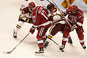 Sean Malone (Harvard - 17), Neal Pionk (UMD - 4), Nathan Krusko (Harvard - 13) - The University of Minnesota Duluth Bulldogs defeated the Harvard University Crimson 2-1 in their Frozen Four semi-final on April 6, 2017, at the United Center in Chicago, Illinois.