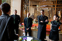 Damien Barbot, the maître d'hôtel, briefs his staff before lunchtime service at Yoshi restaurant at the Metropole Hotel, Monaco, 23 March 2012