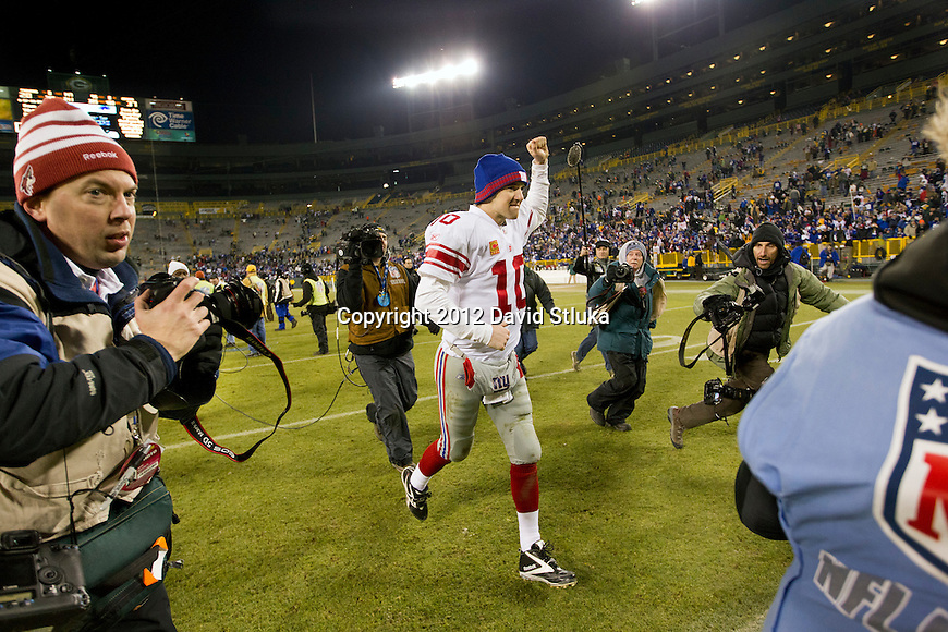 New York Giants quarterback Eli Manning (10) celebrates a victory after an NFL divisional playoff football game against the Green Bay Packers on January 15, 2012 in Green Bay, Wisconsin. The Giants won 37-20. (AP Photo/David Stluka)