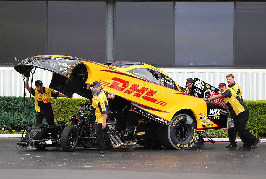 Feb 10, 2017; Pomona, CA, USA; Crew members push the car of NHRA funny car driver J.R. Todd during qualifying for the Winternationals at Auto Club Raceway at Pomona. Mandatory Credit: Mark J. Rebilas-USA TODAY Sports
