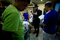 Jewish travellers and residents of the popular Thai tourist island of Koh Samui pray in the Chabad House of Koh Samui with Rabbi Goldshmid (center) during Chanuka celebrations on 17th December 2009. .Koh Samui is the smaller of 2 islands next to each other, world renowned for the monthly full moon rave parties on the beach..Photo by Suzanne Lee / For Chabad Lubavitch
