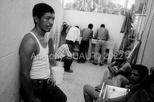 Nuevo Laredo, Tamaulipas<br /> Mexico<br /> June 7, 2007<br /> <br /> Casa del Migrante Nazareth, is a migrant shelter in the border town of Nuevo Laredo, were migrant?s, mostly from central and south America, can receive three days of free food and shelter. The house is run by a Catholic priest, nuns and lay clergy of the small, nearby church of Saint Joseph, patron saint of workers. Most migrants spend a month jumping trains to arrive at this shelter on the USA Mexican border. Many come in contact with violent gangs and Mexican authorities that can beat and rob them while on the trains. To cross the Rio Bravo river into the United States they usually are in the hands of Mexican Coyotes, guides who bring them across for a fee. Nuevo Laredo is a border city that has fallen victim to a surge of drug related violence. It has been called the murder capital of the world.<br /> <br /> Alvaro Murcia (left) Honduras waits to travel into the USA.