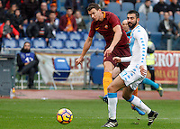 Roma&rsquo;s Edin Dzeko, left, kicks the ball as he is challenged by Napoli&rsquo;s Raul Albiol during the Italian Serie A football match between Roma and Napoli at Rome's Olympic stadium, 4 March 2017. <br /> UPDATE IMAGES PRESS/Riccardo De Luca