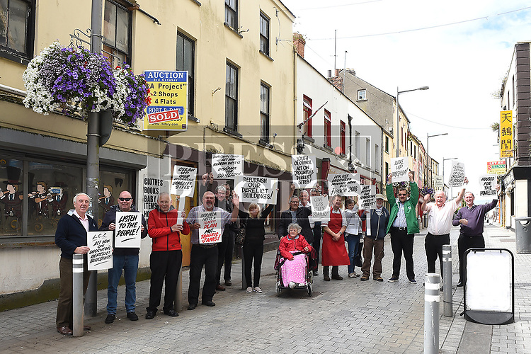 Frank Godfrey leading a protest obout the state of the buildings on Narrow West street. Photo:Colin Bell/pressphotos.ie