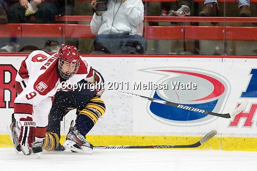 Danny Biega (Harvard - 9), Bryce Van Brabrant (Quinnipiac - 12) - The Harvard University Crimson and Quinnipiac University Bobcats played to a 2-2 tie on Saturday, November 5, 2011, at Bright Hockey Center in Cambridge, Massachusetts.