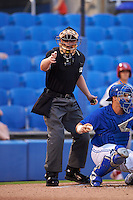 Umpire Richard Riley makes a call during the second game of a doubleheader between the Palm Beach Cardinals and Dunedin Blue Jays on July 31, 2015 at Florida Auto Exchange Stadium in Dunedin, Florida.  Dunedin defeated Palm Beach 4-0.  (Mike Janes/Four Seam Images)