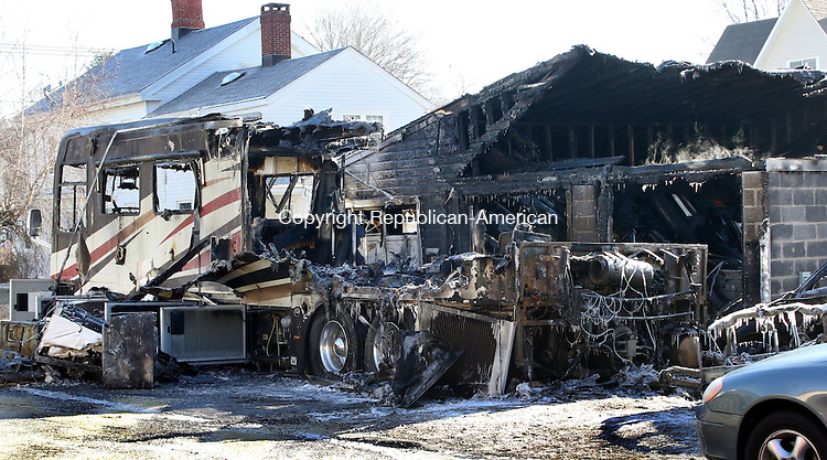 THOMASTON CT. 06 January 2015-010616SV02-Fire ripped through an RV and a 2 car garage on High Street in Thomaston early Wednesday. A few area town responded to help firefighters.<br /> Steven Valenti Republican-American