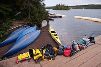 Preparing to load a sea kayak for a paddling trip at Isle Royale National Park.
