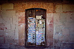 The colonial walls of Oaxaca, Mexico are covered in decades of paint and fliers and messages. Seen November 2009.