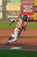 Devan Ahart (18) of the Ogden Raptors hustles towards third base against the Great Falls Voyagers on July 17, 2014 at Lindquist Field in Ogden, Utah. (Stephen Smith/Four Seam Images)