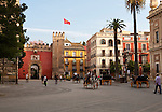 Horse and carriage rides for tourists through the historic central areas of Seville, Spain