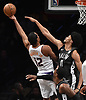 Jarrett Allen #31 of the Brooklyn Nets, right, challenges a shot by T.J. Warren #12 of the Phoenix Suns during an NBA gameat the Barclays Center in Brooklyn, NY on Sunday, Dec. 23, 2018. The Nets won by score of 111-103.
